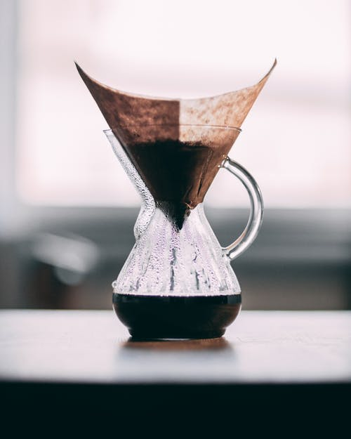 Clear Glass Pitcher with Cone Filter and Black Coffee