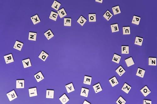 White Scrabble Blocks with Black Letters