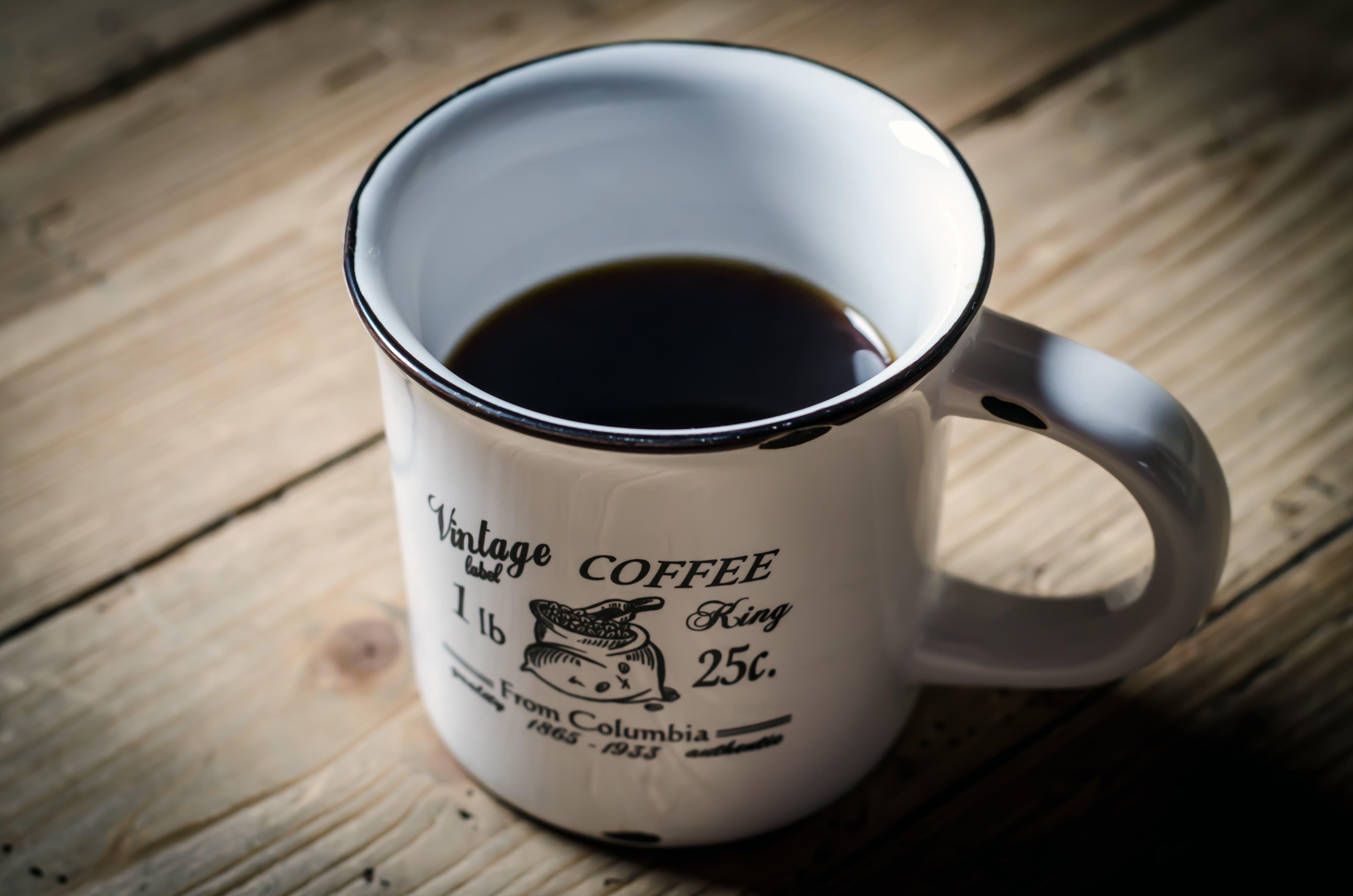 White and Black Mug With Black Liqour