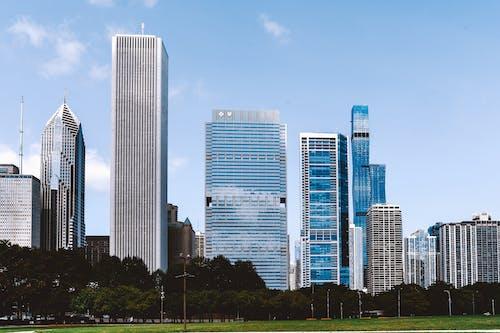 Contemporary megapolis architecture against cloudless sky