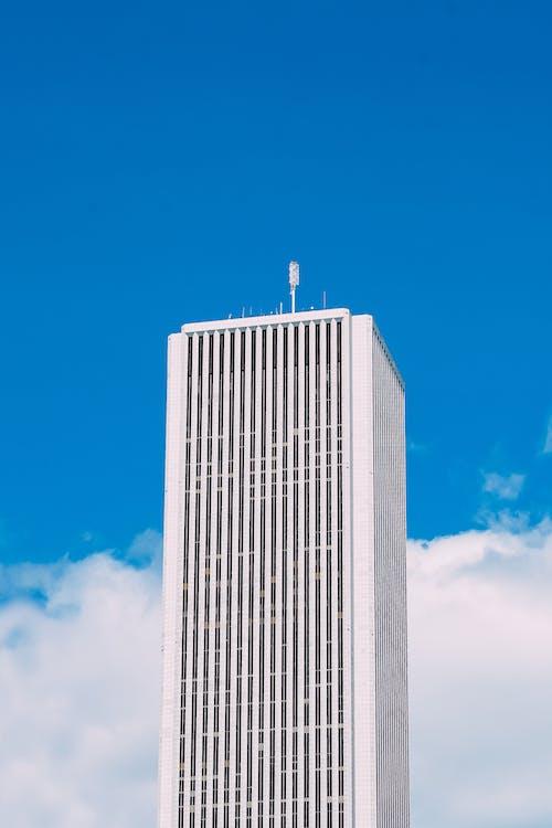 Supper tall white skyscraper against blue sky