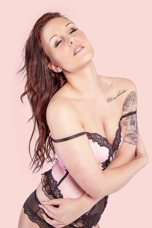Woman in Pink and Black Lingerie