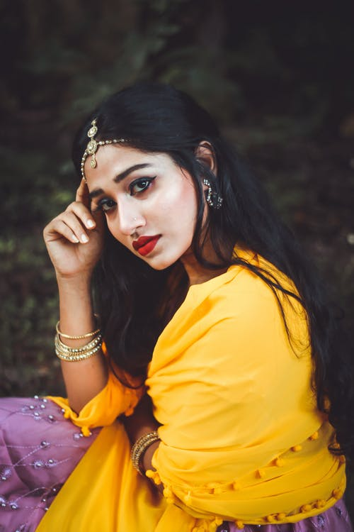 Indian woman with Maang tikka in hair in park