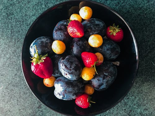 Assorted Fruits on Black Round Plate