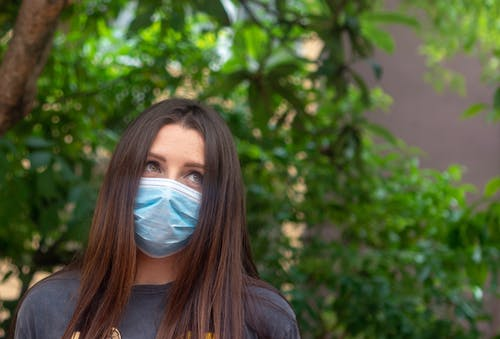 Free stock photo of adult, brunette, face, facemask