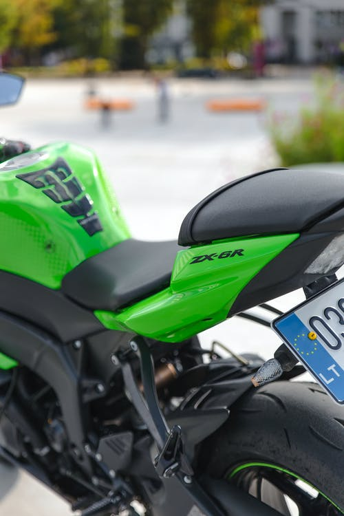 Green and Black Motorcycle on Road