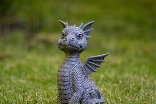 Gray Dragon Figurine on Green Grass