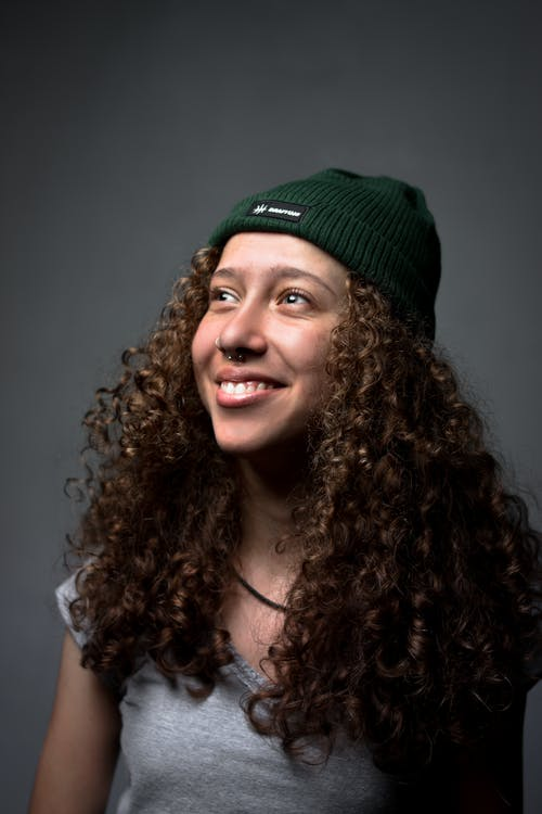 Woman in Green Knit Cap Smiling