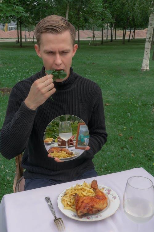 Man eating salad instead of junk food in park