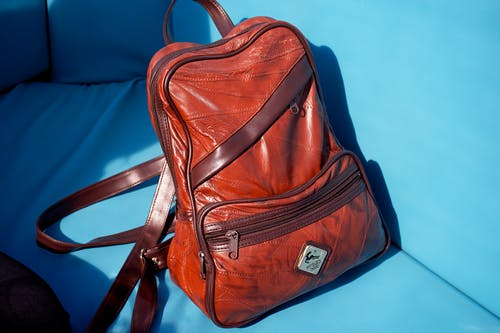 Brown Leather Backpack on White Textile