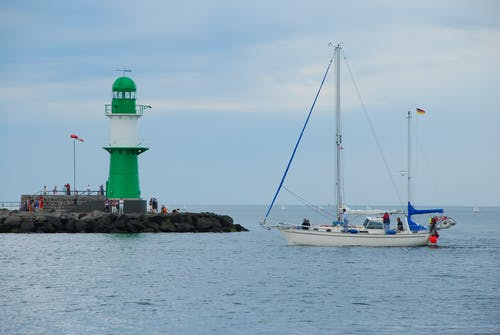 A Sailboat Anchored by the Warnemunde Lighthouse