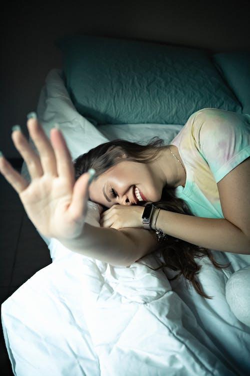 Sleepy woman lying in bed in morning