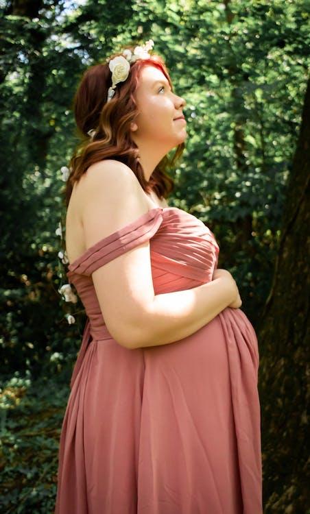 Woman in Pink Dress Standing Near Green Tree
