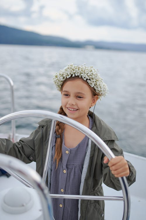Smiling little girl sailing in sea