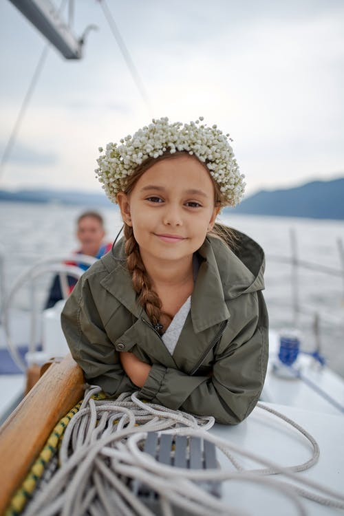 Cheerful little girl on boat in sea