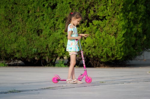 Free stock photo of alley, child, kick scooter, little girl