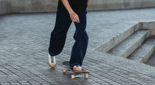 Skater rolling on city in daytime