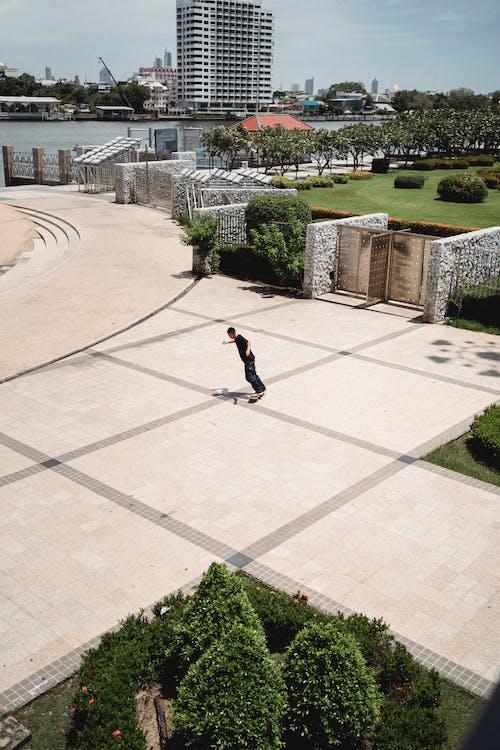 Man riding skateboard in modern city park
