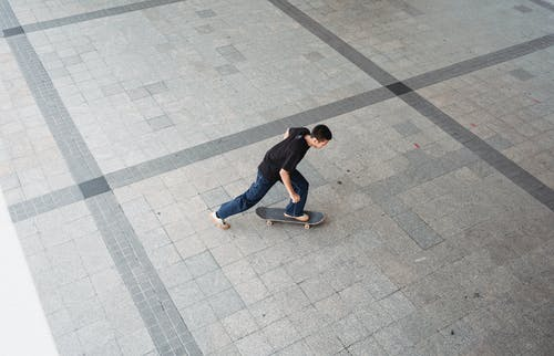 Man riding skateboard on city sidewalk