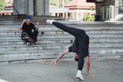 Asian friends spending time on street