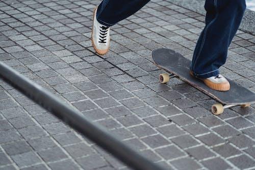 Man riding skateboard on concrete block
