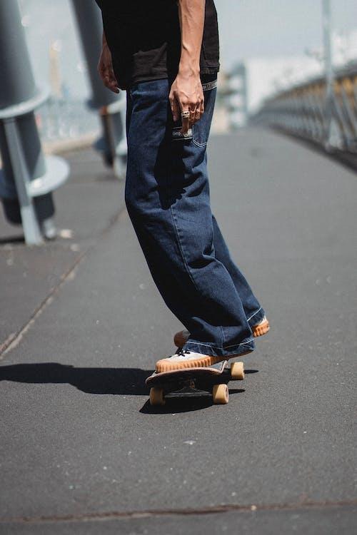 Crop man on skateboard in city