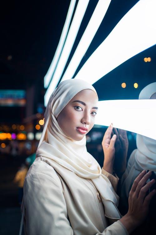 Woman in White Hijab Holding White Umbrella