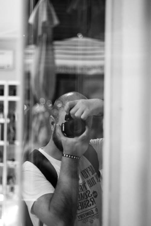 Free stock photo of black and white, canon, man, mirror
