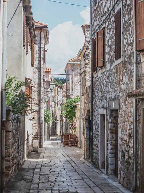 Empty Street Between Concrete Houses