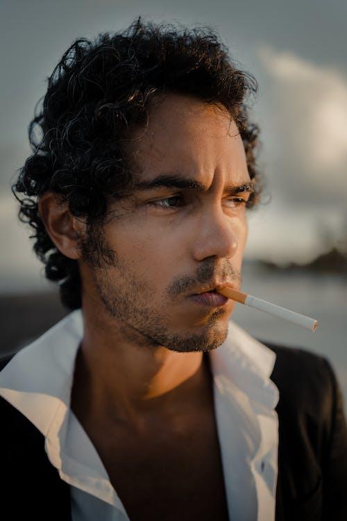 Man in White Collared Shirt Smoking