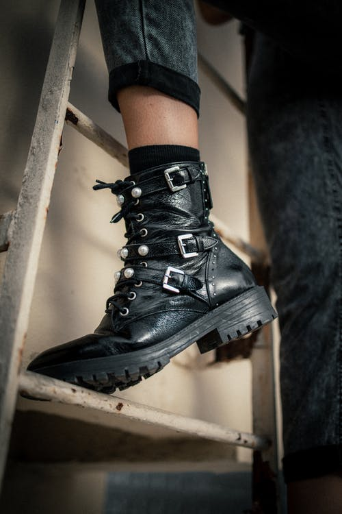 Woman Wearing Black Leather Lace Up Boots