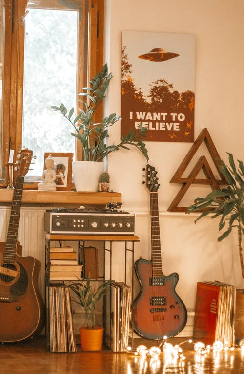 Brown and White Electric Guitar on Guitar Stand