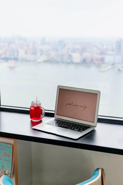 Macbook Air on Black Table
