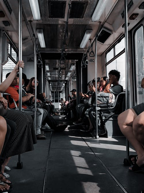 Diverse people riding in train of underground