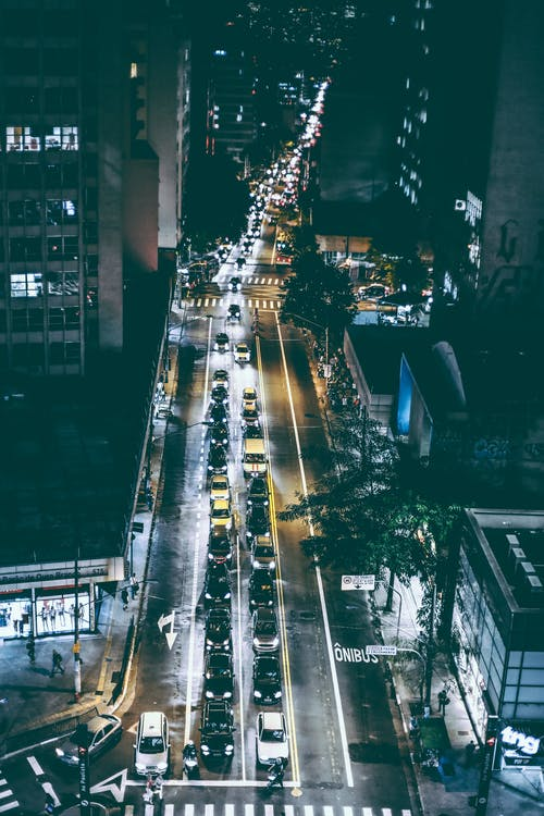 Cars on Black Asphalt Road during Nighttime