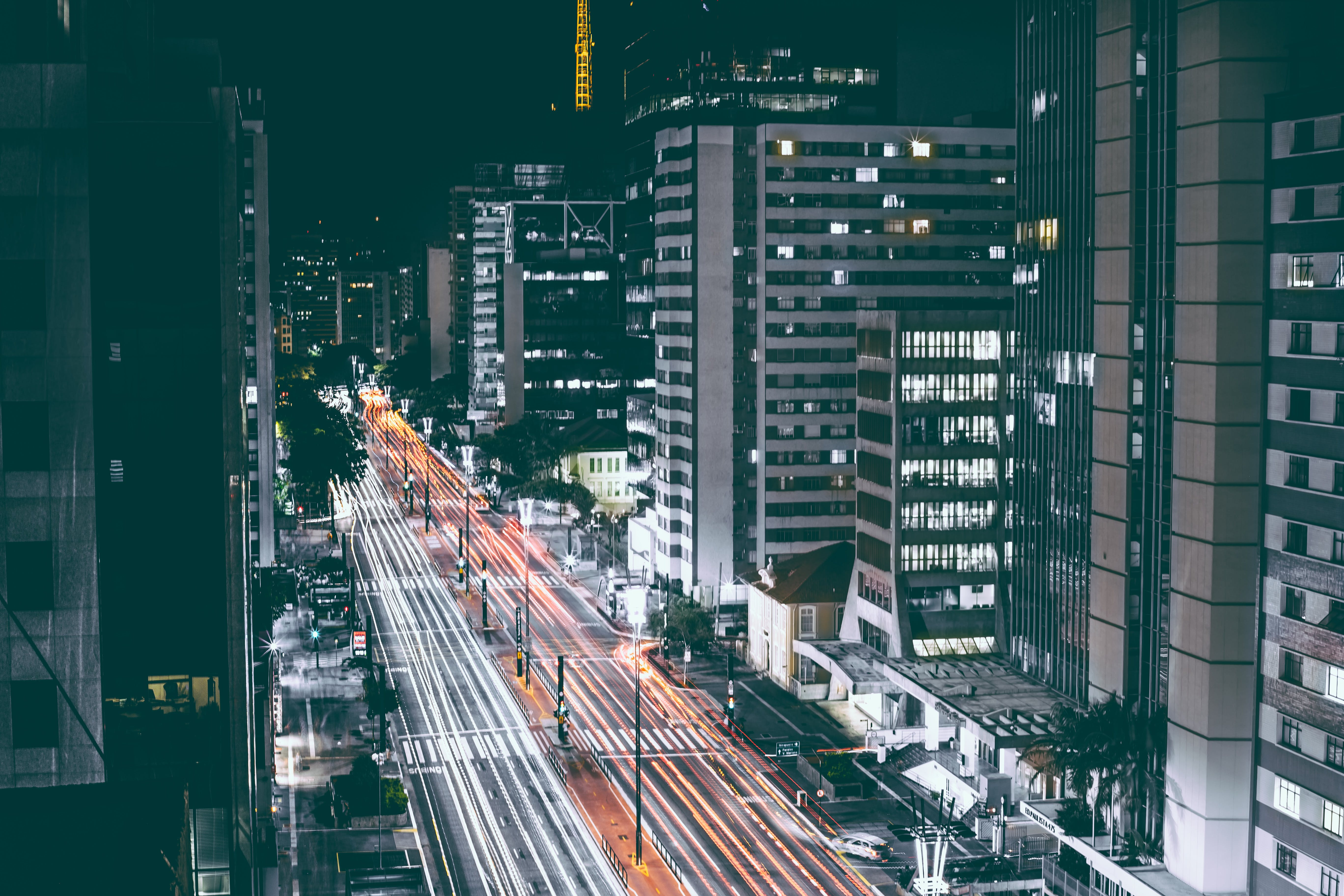 High Rise Buildings Beside Road during Nighttime