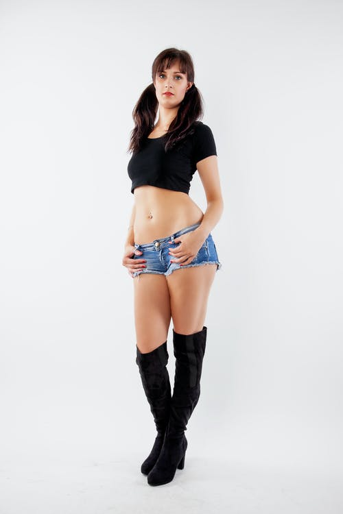 Woman in Black Crop Top and Blue Denim Shorts