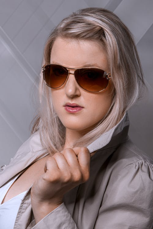 Woman in Black Leather Jacket Wearing Brown Sunglasses