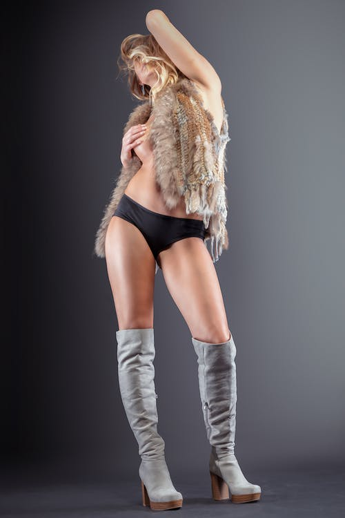 Woman in Brown Fur Coat and Black Shorts