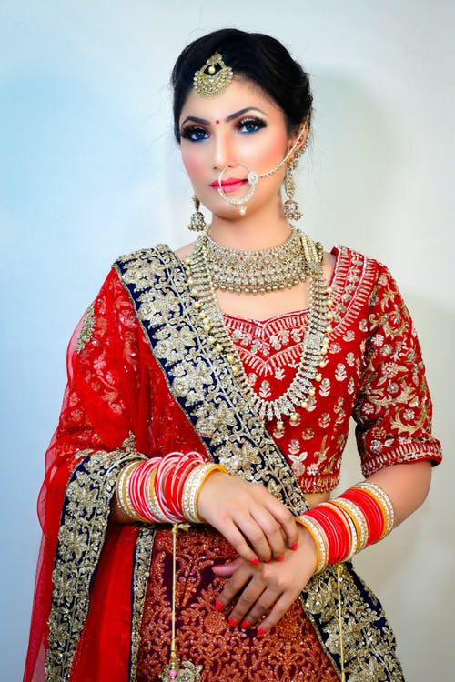 Indian female wearing traditional clothes with jewelries and piercing