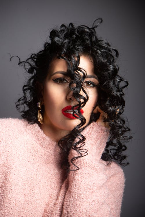 Sensual curly haired woman with makeup and mouth opened