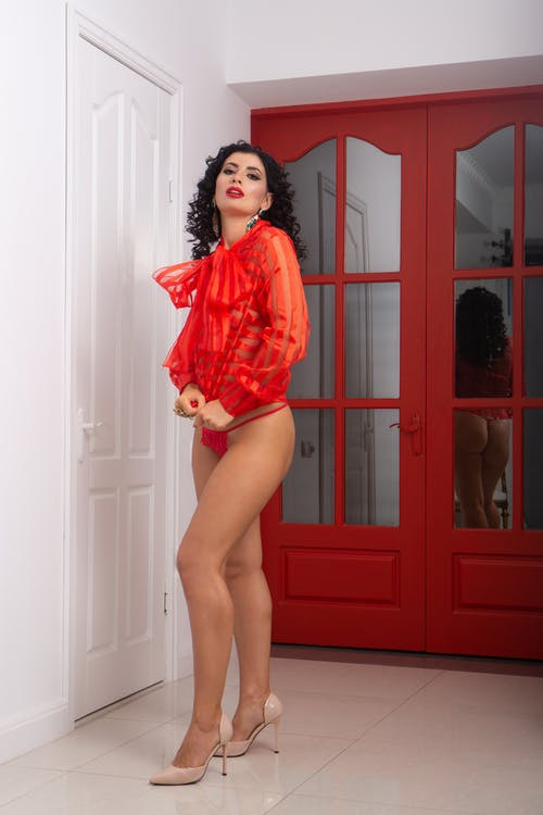 Sexy woman in red underwear and blouse