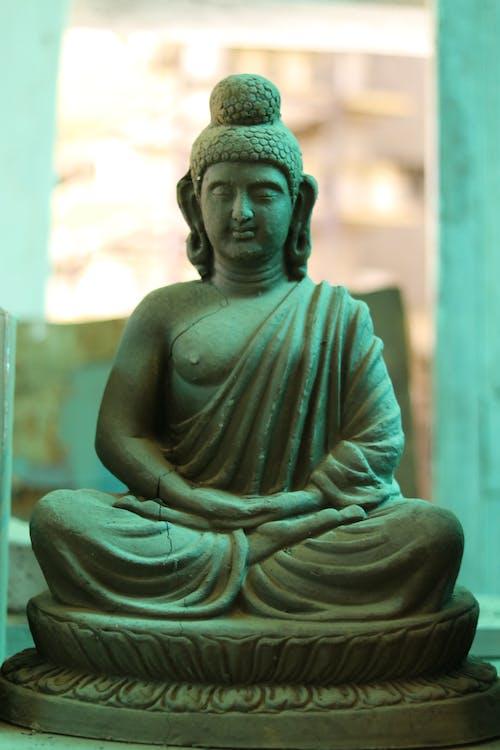 Brown Concrete Buddha Statue