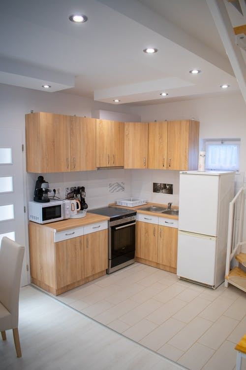 Interior of kitchen with modern furniture and equipment for cooking