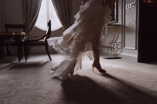 Person in White Dress Running