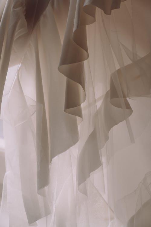White Textile on White Textile