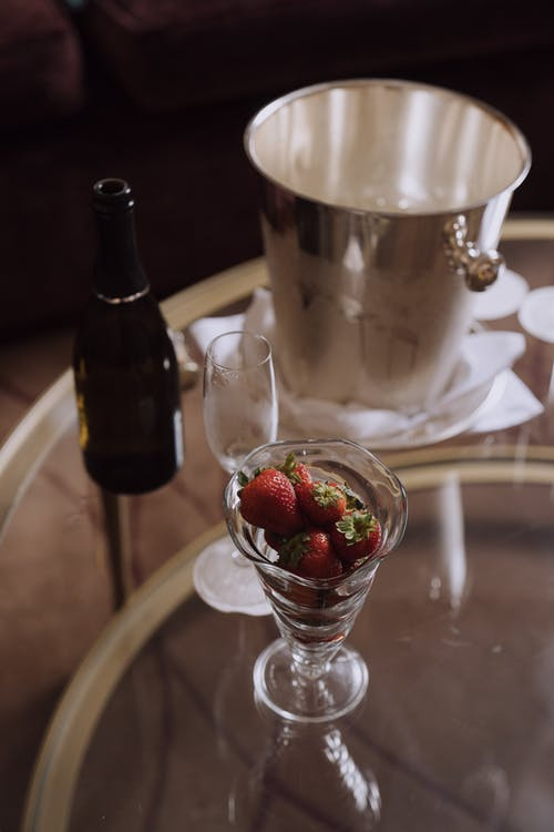 Close-Up View of a Wine Glass and Strawberries