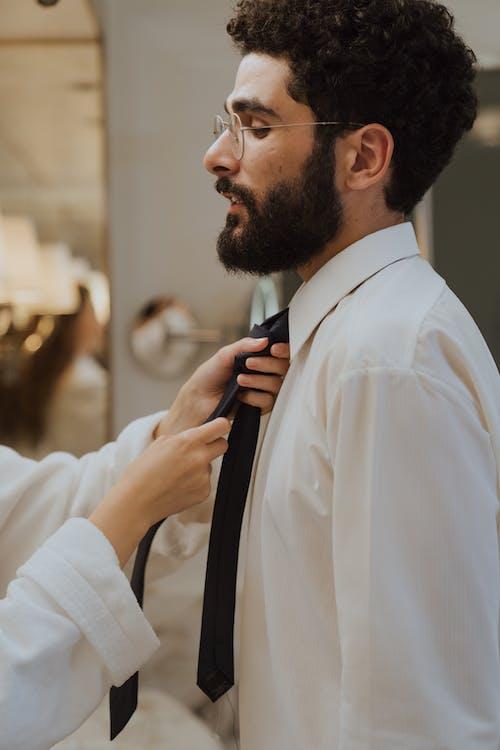 Man in White Dress Shirt with Black Necktie