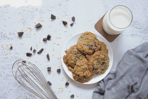 Cookies on Plate and a Glass of Milk
