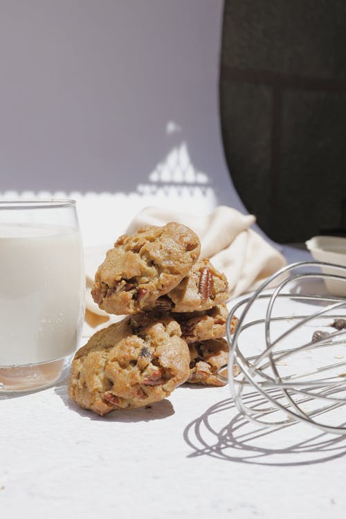 Stack of Cookies Beside a Glass of Milk